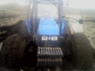 出售上2009年海纽荷兰10004拖拉机带一旱田旋耕机